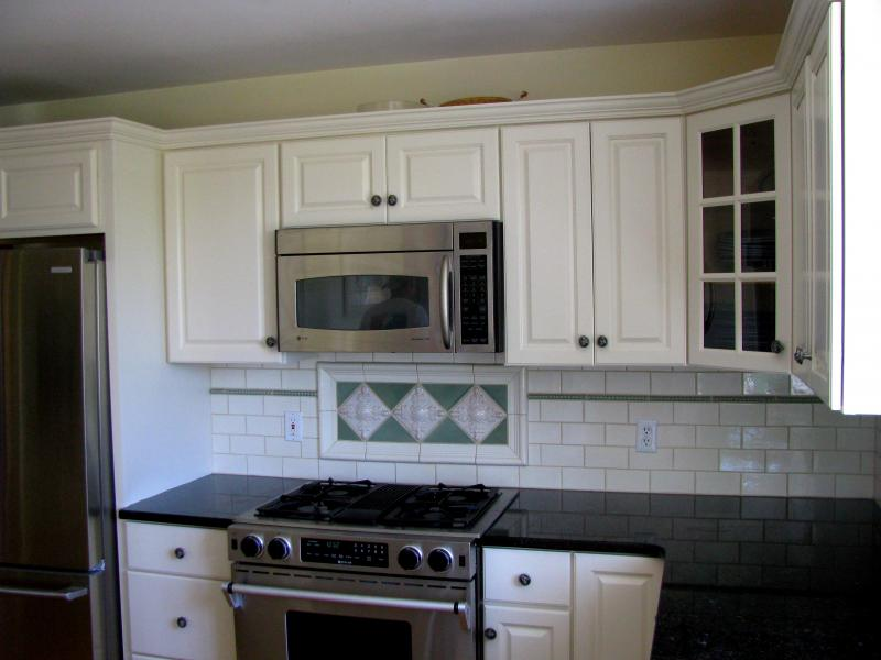professional cabinet refinishing makes old kitchen cabinets look brand new at a fraction of the cost of replacing them these were painted white to brighten - Professional Painting Kitchen Cabinets