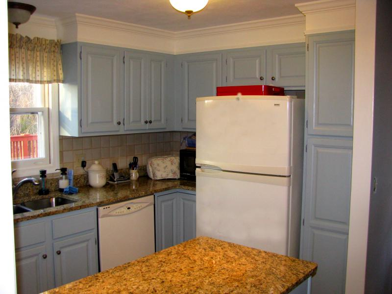 as part of a kitchen makeover project refinished kitchen cabinets